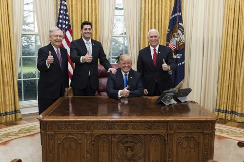 President Donald J. Trump celebrates the passage of the Tax Cuts Act with Vice President Mike Pence, Senate Majority Leader Mitch McConnell, and Speaker of the House Paul Ryan
