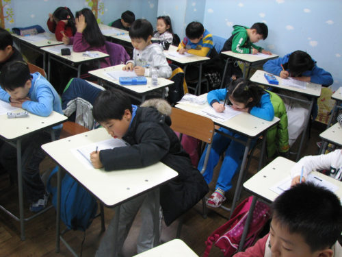 Students in a special academic training school in South Korea.