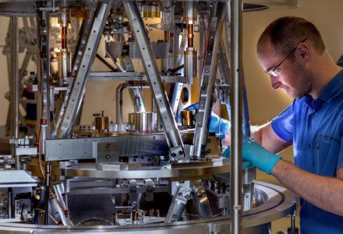 Scientist preparing the BIPM Kibble balance for a measurement