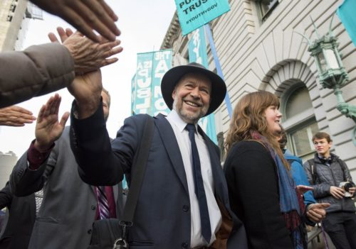 Climate change scientist Dr. JAMES HANSEN, center greets well-wishers as her enter the courthouse for a hearing in the Juliana v. U.S. climate change lawsuit in the 9th Circuit Court of Appeals in San Francisco. The court was holding a hearing on a motion by the Trump administration to stop the lawsuit from proceeding to trial. The case involves 21 young people suing the federal government over their constitutional right to a stable climate. They hope to force the Trump administration to institute a science based climate recovery program. (Robin Loznak)