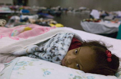 Houston, TX., 9/10/2005 -- Johnetra Kissach rests at the George R. Brown shelter in Houston, following being evacuated from New Orleans due to Hurricane Katrina. FEMA photo/Andrea Booher