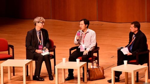 Chinese scientist He Jiankui (M) at his panel session with hosting panel members Robin Lovell-Badge (L) and Matthew Porteus (R) at the Second International Summit on Human Genome Editing in Hong Kong.