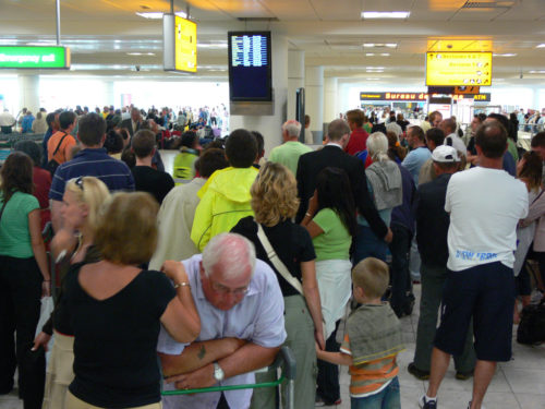 A scene of frustration at Gatwick airport as some passengers wait more than an hour for their luggage to appear