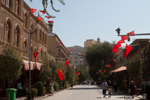 Kashgar street, flags and security cameras