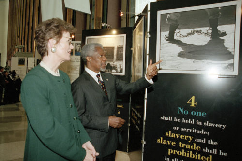 Secretary-General Kofi Annan points out display illustrating Article 4 of the Universal Declaration of Human Rights to Mary Robinson (left), United Nations High Commissioner for Human Rights. The display is part of an exhibit produced by the Department of Public Information (DPI) in the Visitors Lobby at Headquarters. Its opening coincides with the fiftieth anniversary of the Declaration.