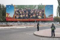 Xi Jingping billboard, police on curb.