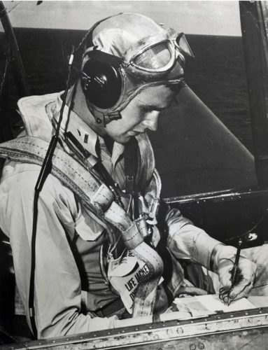 The later U.S. president George Herbert Walker Bush as a pilot, seated in a Grumman TBM Avenger aircraft.