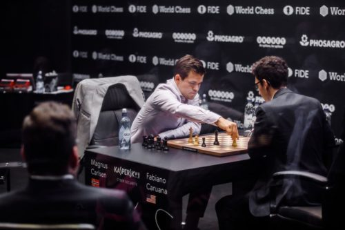 Magnus Carlsen (left) and Fabiano Caruana play a tie-breaking game in the world chess championships.