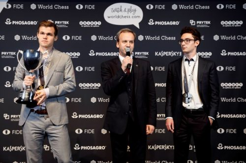 Magnus Carlsen (left, with trophy) and Fabiano Caruana with awards after the world chess championships.