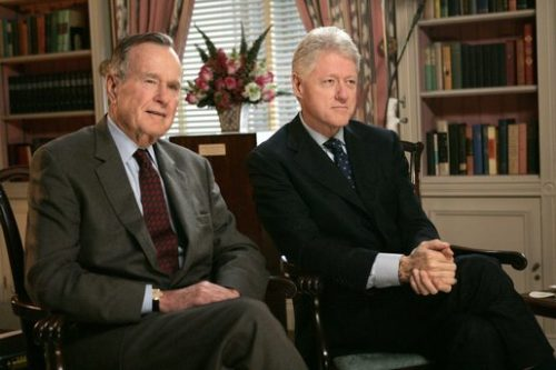 Former Presidents George H. W. Bush and Bill Clinton film a public service announcement.
