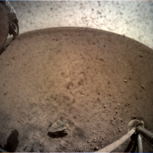 NASA's InSight Lander touched ground safely on Mars on Monday. This is a picture it sent back of the ground below it.
