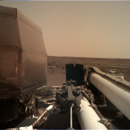 The InSight has unfolded its solar panels and is testing different parts of its system to make sure that there are no problems. This is another picture the InSight has sent back.