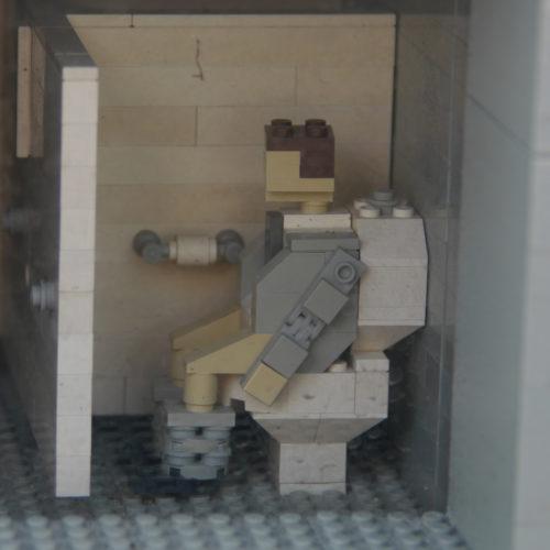 Lego figure on Lego toilet.