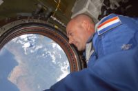 European Space Agency astronaut Andre Kuipers of the Netherlands looks through the Earth observation window in the Destiny laboratory on the International Space Station soon after arriving in a Soyuz spacecraft for several days' stay onboard the Earth-orbiting complex.