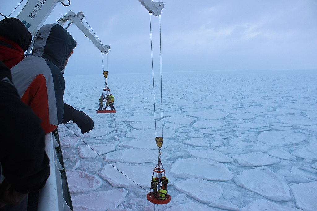 South African scientists work putting trackers on the ice in the Marginal Ice Zone of Antarctica on the Cape Agulhas II during a scientific cruise to the area in the winter of 2017