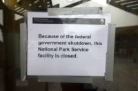 "Sign saying ""Because of the federal government shutdown, this National Park Service facility is closed."""