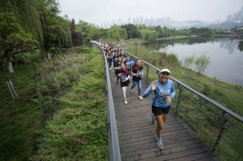 Mina Guli runs with school kids through Chongqing city, China, during the 6 River Run expedition, on the 11th April 2017