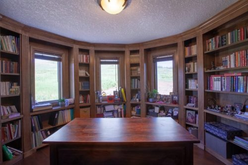 Wooden desk in round library.