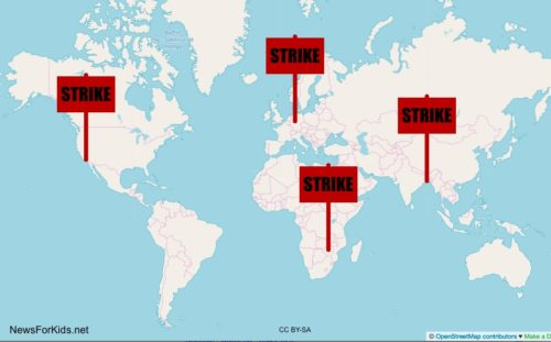 "Map of world showing four signs with the word ""STRIKE""."