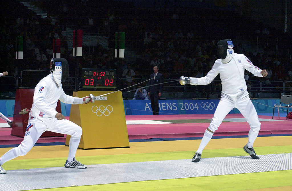 U.S. Air Force 2nd Lt. Weston Kelsey (right) fences for advancement against Russian Igor Tourchine (left) in the second round of the Olympic Men's Individual Epee event at the Helliniko Fencing Hall just outside Athens, Greece, on Aug. 17, 2004. This was Kelsey's first Olympic attempt and he did not advance to the third round.