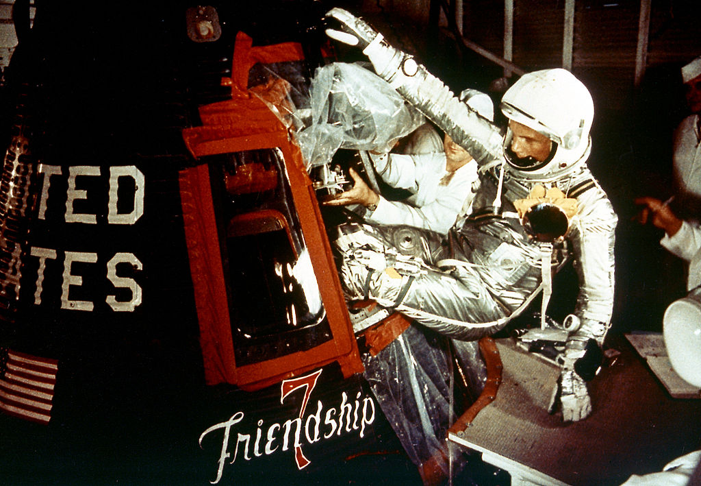 Astronaut John Glenn enters the Mercury spacecraft, Friendship 7, prior to the launch of MA-6 on February 20, 1962 and became the first American who orbited the Earth. The MA-6 mission was the first manned orbital flight, and lasted for five hours, orbiting the Earth three times.