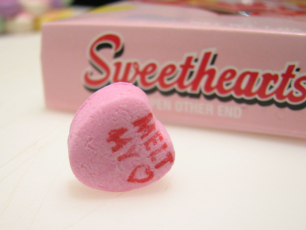 """Sweetheart saying """"Melt My Heart"""" in front of Sweethearts box."""