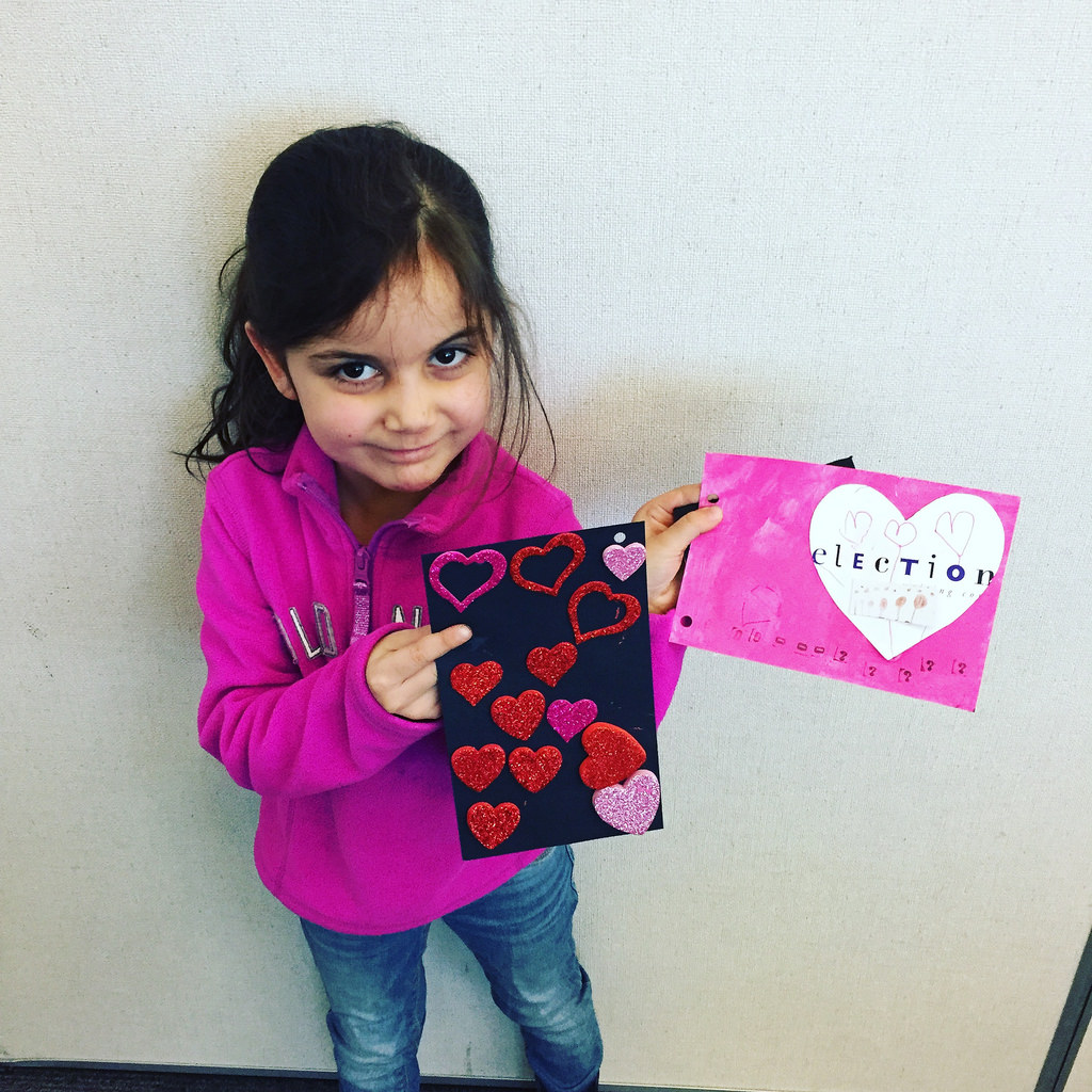 A young girl holds some handmade Valentine's cards made at the Vancouver City Library.