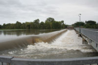 Flooded Weir in Townsville, 2009. After 28 days of rain - 4.5 feet of water over the dam. that bridge is 15 feet high!