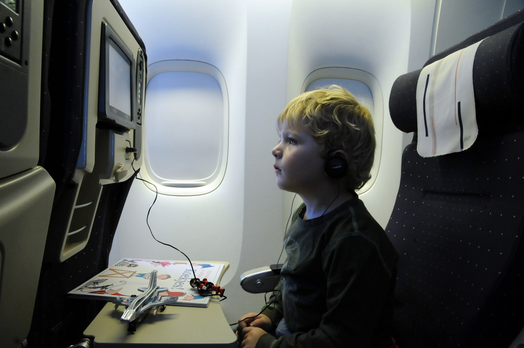 Child watching inflight entertainment system.