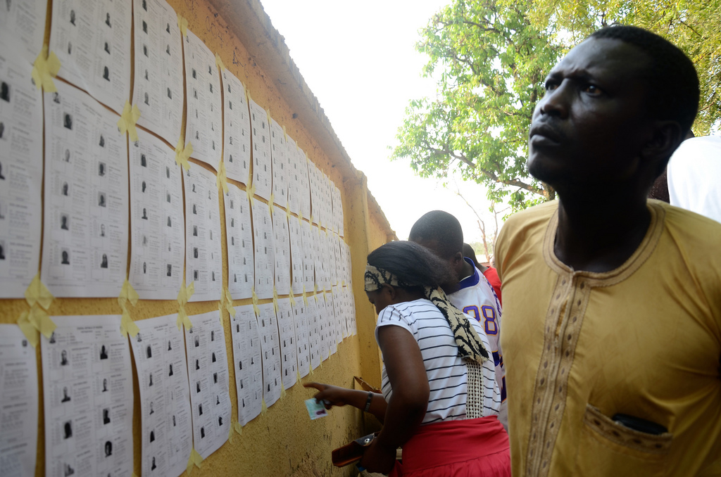 The Commonwealth Observer Group, chaired by the former President of the United Republic of Tanzania Jakaya Kikwete, witnessed the general elections in Nigeria. Voters look for information about candidates on a bulletin board.