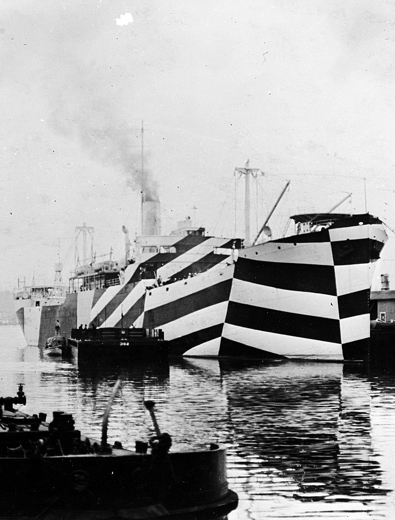 Ship painted with dazzle camouflage. In port, circa November 1918. Note how her Dazzle camouflage greatly distorts the apparent aspect of her bow. Photograph from the Bureau of Ships Collection in the U.S. National Archives.