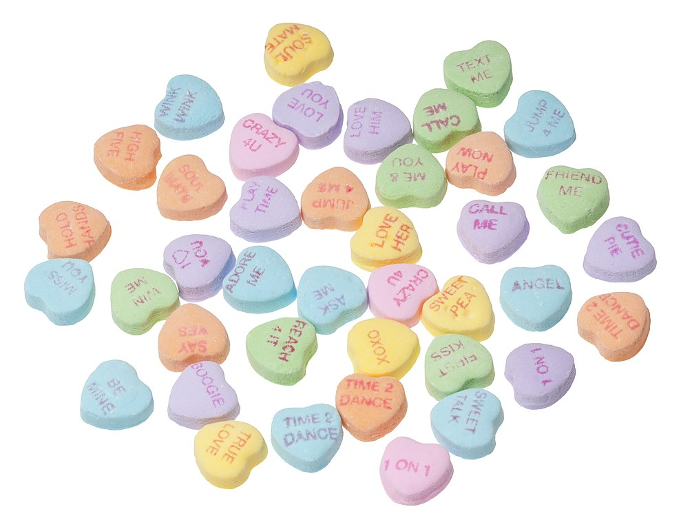 An array of Necco Sweethearts (conversation hearts). Little, chalky pieces of candy with phrases written on them; available around Valentine's Day.