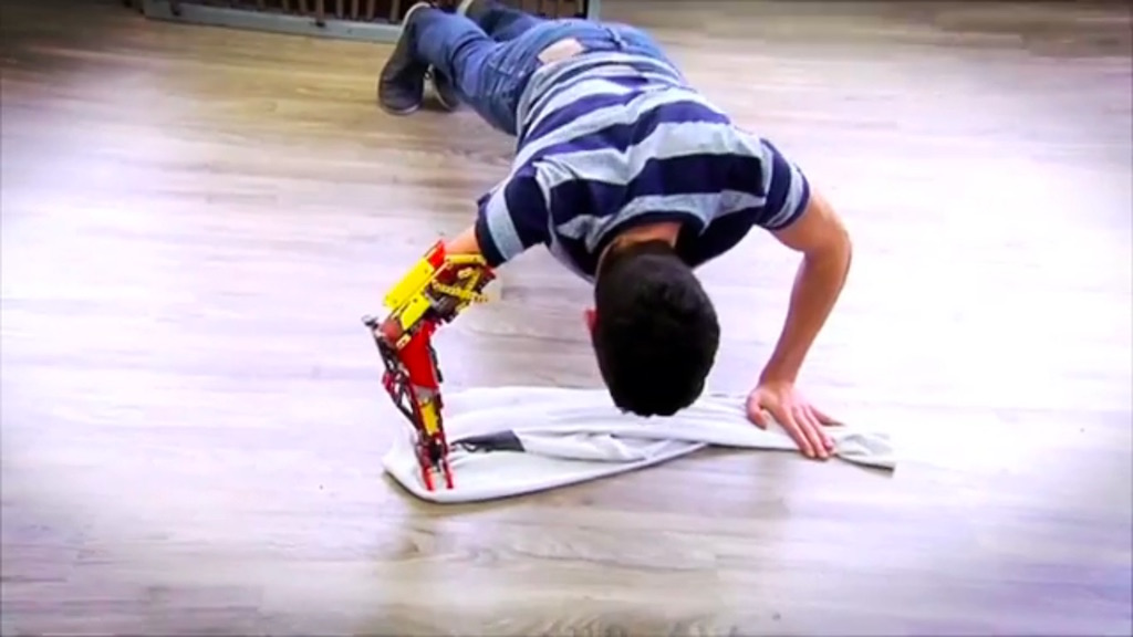 David Aguilar does a pushup with his Lego arm, the MK-I.