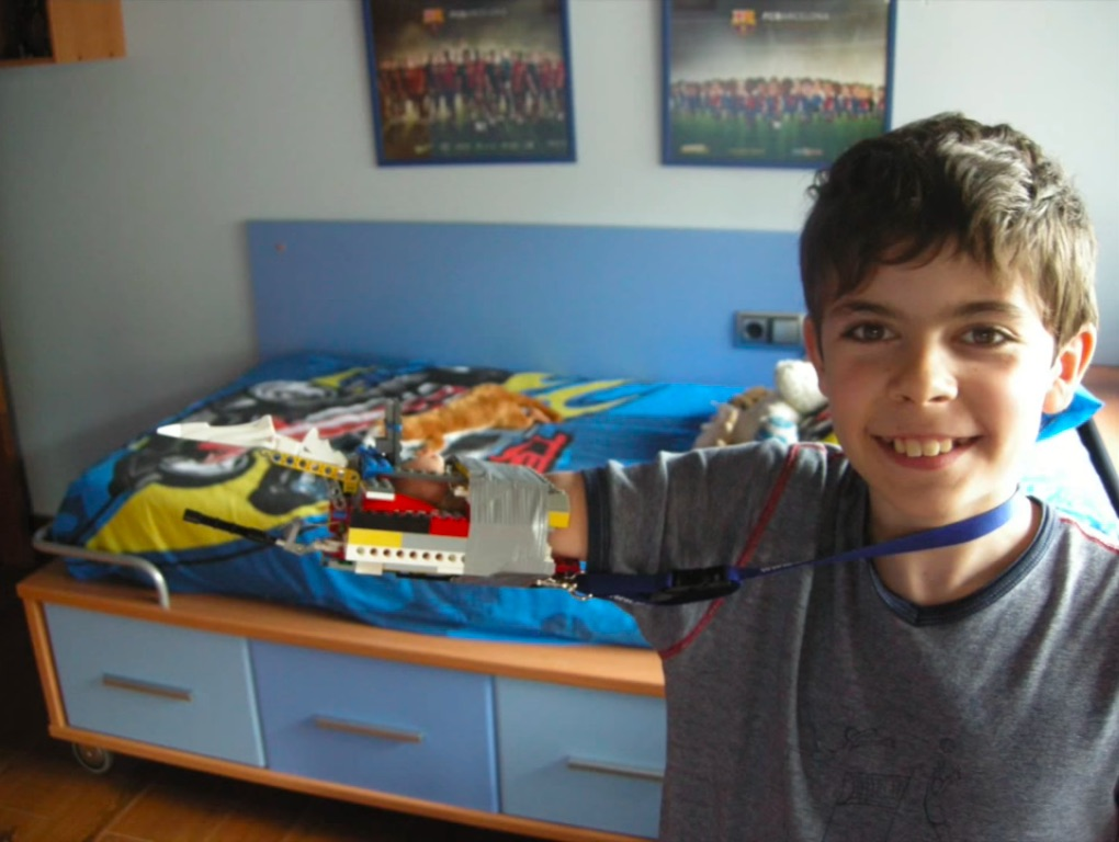David Aguilar poses with the Lego arm he made when he was nine.