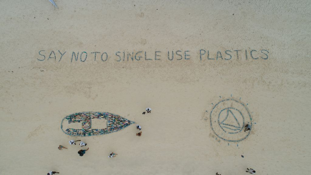 "Beach drawings and the huge slogan ""SAY NO TO SINGLE USE PLASTICS""."