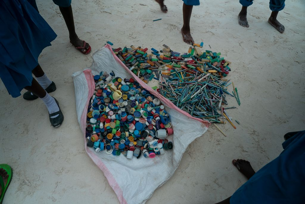 A display of single-use plastic trash collected on a beach.