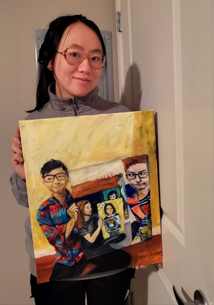 Woman holds painting of the eight paintings that came before her.