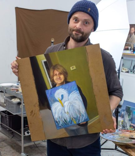 Kristoffer Zetterstrand holding his painting of the picture of Ms. Decker