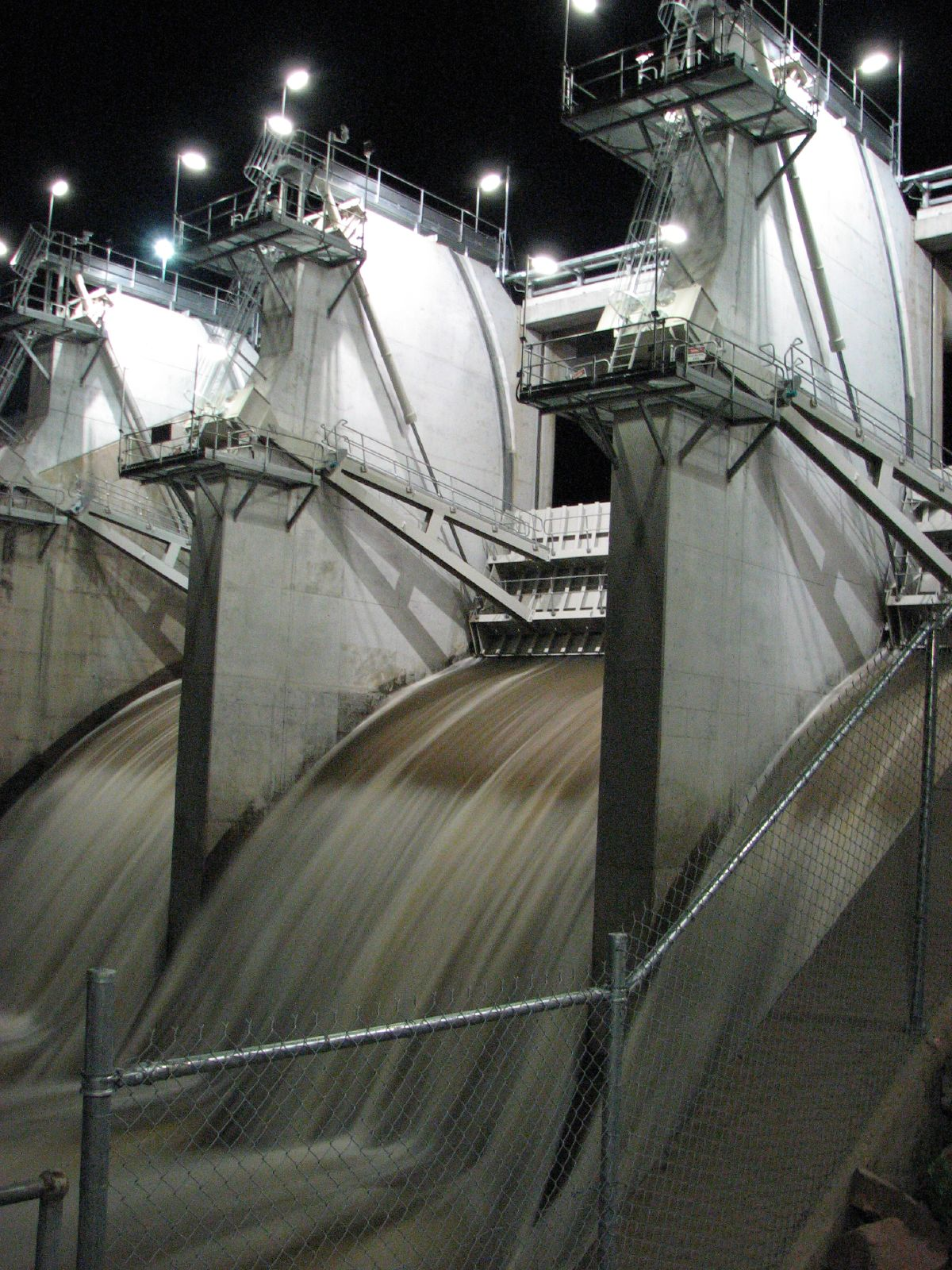 Ross River Dam at night, Floodgates are full open.