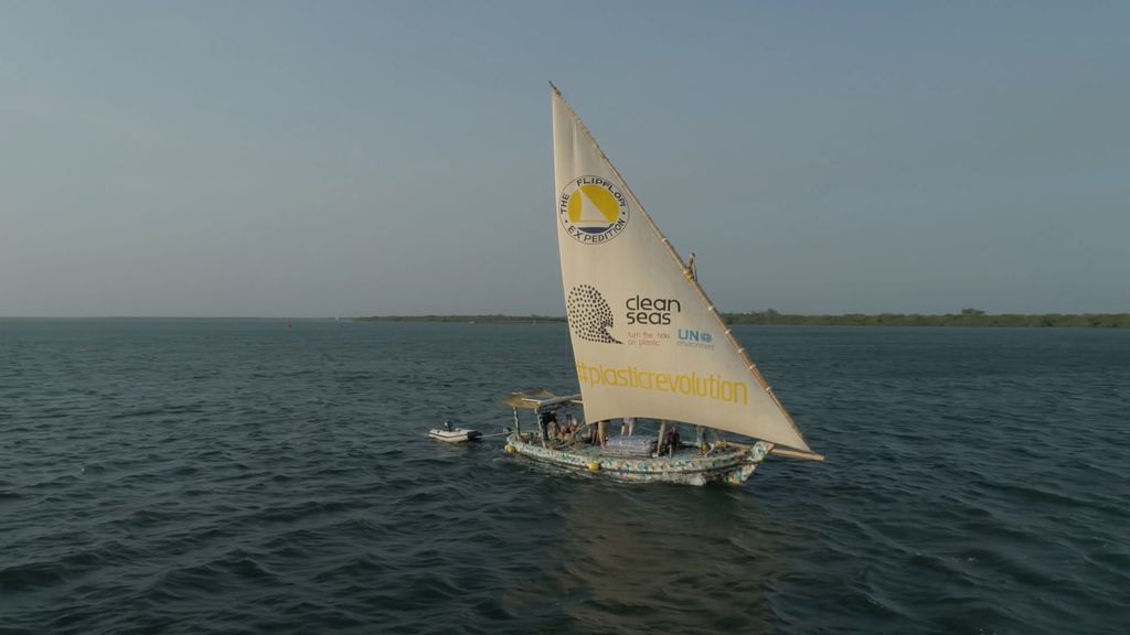 View of the Flipflopi with triangular sail out.