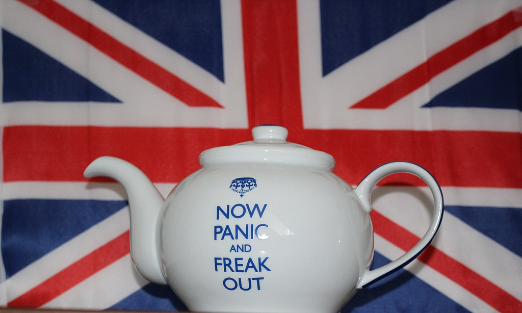 "Brexit Graphic - Teapot in front of British Flag with the words ""Now Panic And Freak Out""."