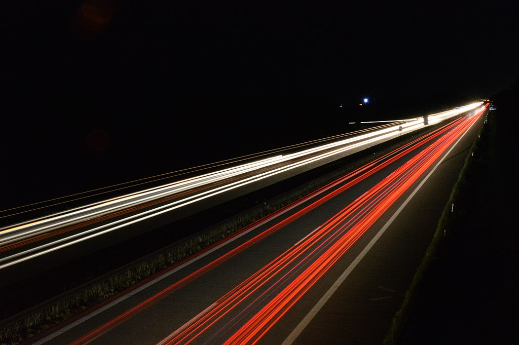 "Long exposure photography of the German Autobahn. The Autobahn is the federal controlled-access highway system in Germany. The official German term is Bundesautobahn, which translates as ""federal motorway"". The literal meaning of the word Bundesautobahn is ""Federal Auto(mobile) Track""."
