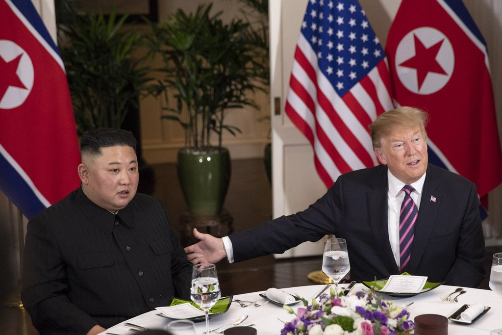 President Donald J. Trump and Chairman Kim Jong Un at dinner in Hanoi