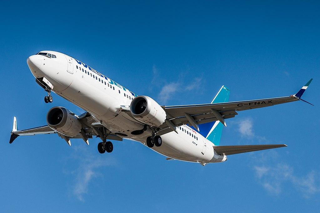 WestJet Boeing 737 MAX 8 landing in Calgary, Alberta, Canada.