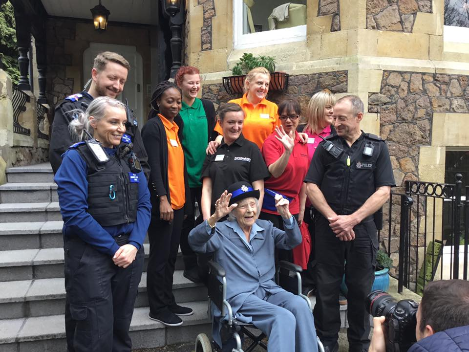 Anne with the police officers and the care home workers.
