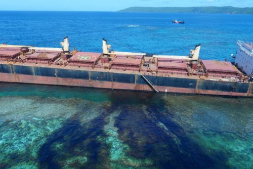 Oil spilling into clear water from Solomon Trader.
