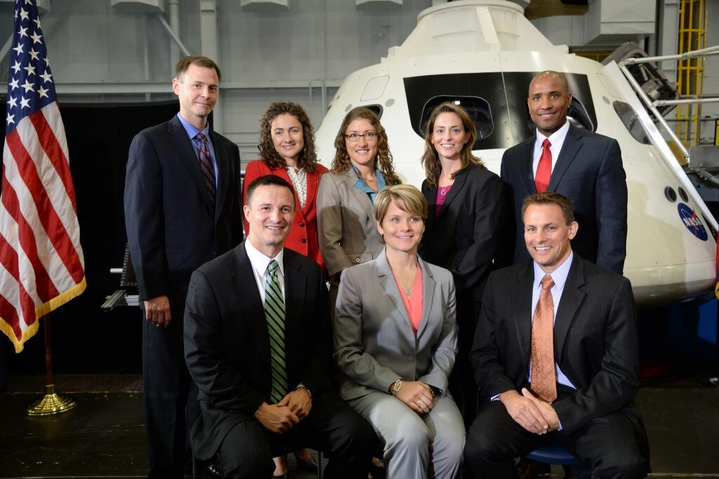Members of NASA's 2013 astronaut class pose with an Orion capsule at NASA's Johnson Space Center in Houston on Tuesday, Aug. 20, 2013. Pictured back row, left to right: Tyler (Nick) Hague, Jessica Meir, Christina Hammock, Nicole Mann, Victor Glover. Picture front row, left to right: Andrew Morgan, Anne McClain, Josh Cassada.