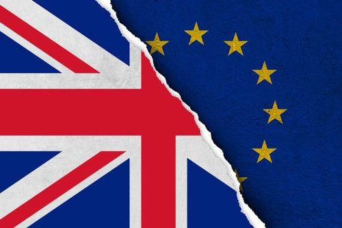 Brexit image - torn UK Flag over EU flag