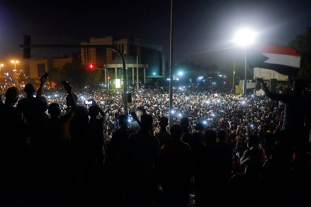 Chanting at night in front of the army HQ in khartoum.