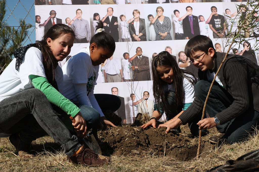 Felix Finkbeiner planting a tree with other kids in Lesotho.